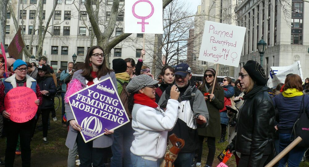 Feminists are taking part in a Planned Parenthood rally in New York City, 2011