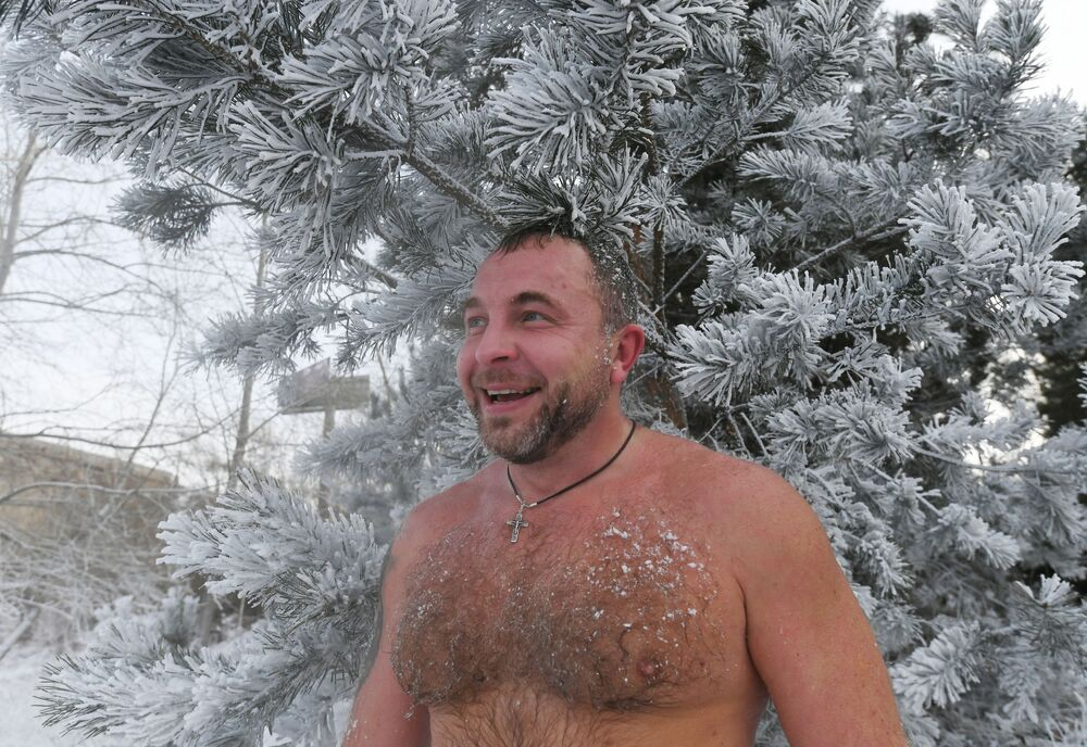 A man smiles after a swim in the icy water in Krasnoyarsk