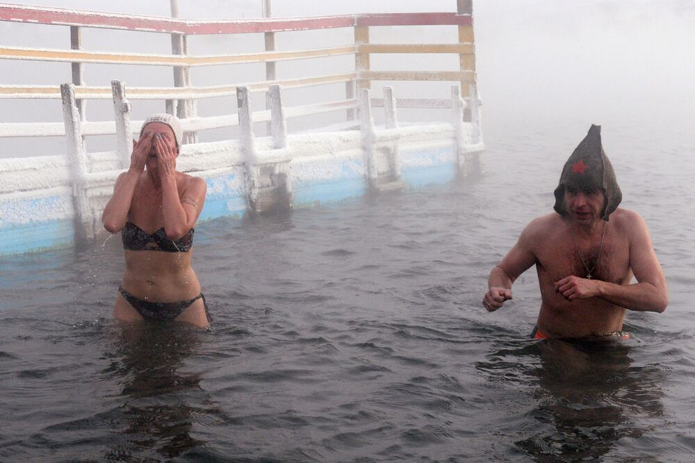 A couple of swimmers during training in the Yenisei River. Experts say it is better to start practising cold water swimming in summer, gradually adjusting yourself to lower temperatures.