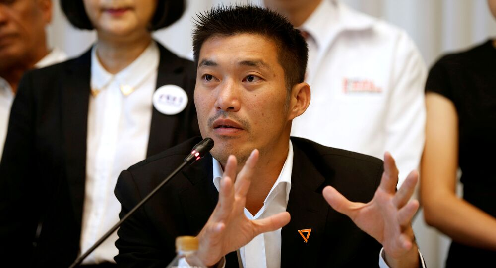 FILE PHOTO: Thanathorn Juangroongruangkit, leader of the Future Forward Party talk during a news conference to form a democratic front in Bangkok, Thailand, March 27, 2019
