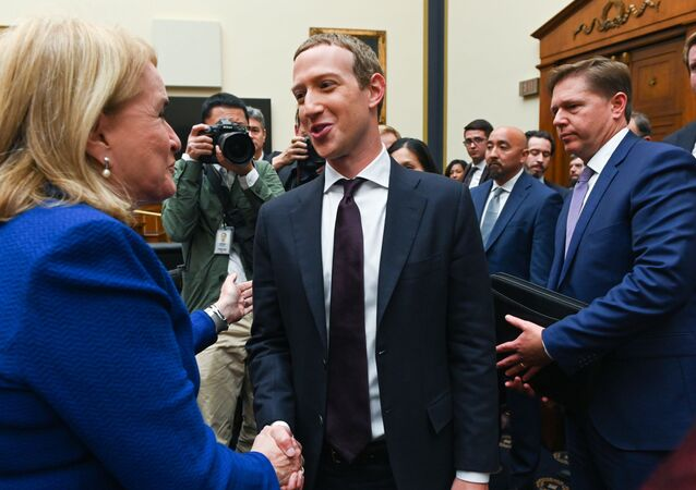Facebook Chairman and CEO Mark Zuckerberg greets Rep. Sylvia Garcia (D-TX) after testifying at a House Financial Services Committee hearing in Washington, U.S., October 23, 2019