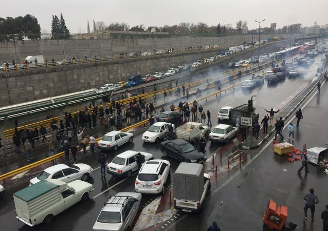 People stop their cars on the highway to protest increased gas prices in Tehran, Iran; 16 November 2019