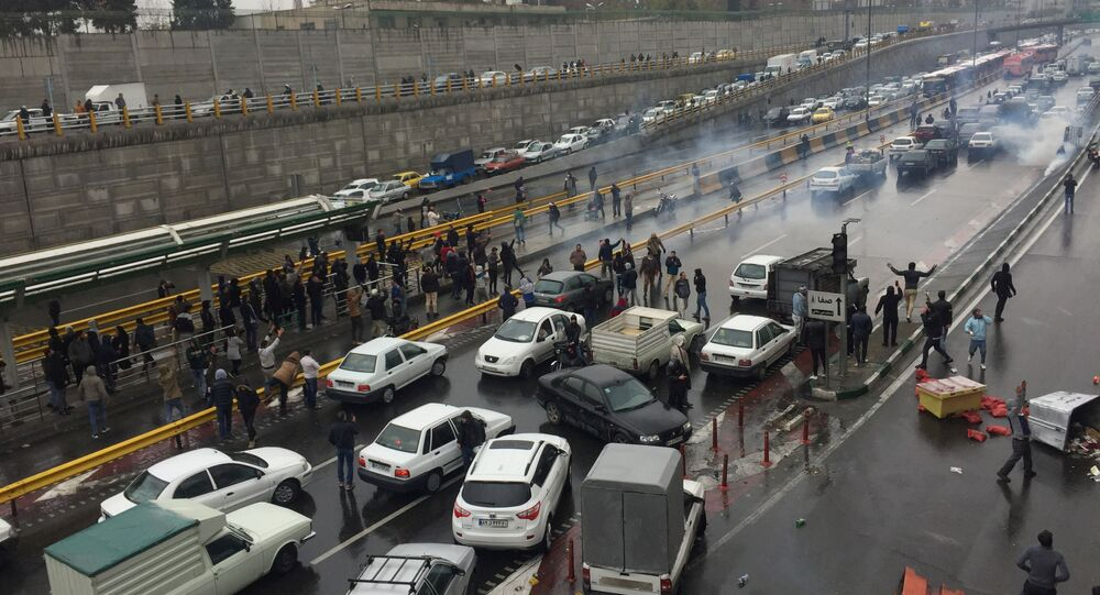 People stop their cars in a highway to show their protest for increased gas price in Tehran, Iran November 16, 2019