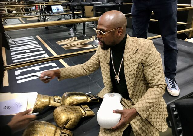 Floyd Mayweather signs gloves at the opening of the Mayweather Boxing + Fitness gym in Torrance, California, U.S., November 16, 2019.  Picture taken November 16, 2019