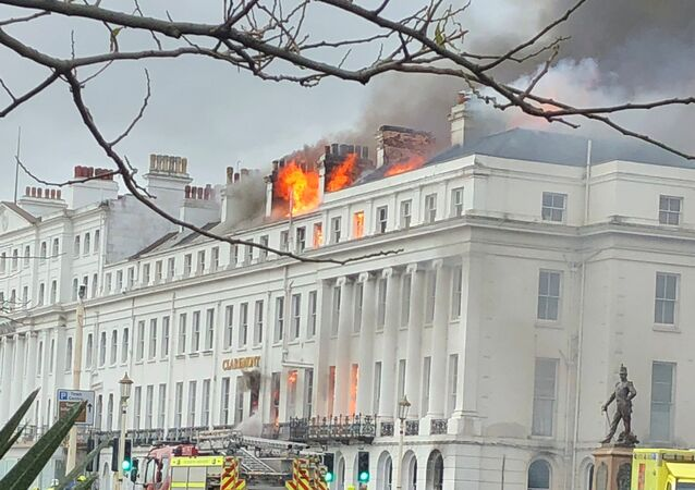 Smoke rises from Claremont Hotel during a fire in Eastbourne, Britain November 22, 2019 in this picture obtained from social media