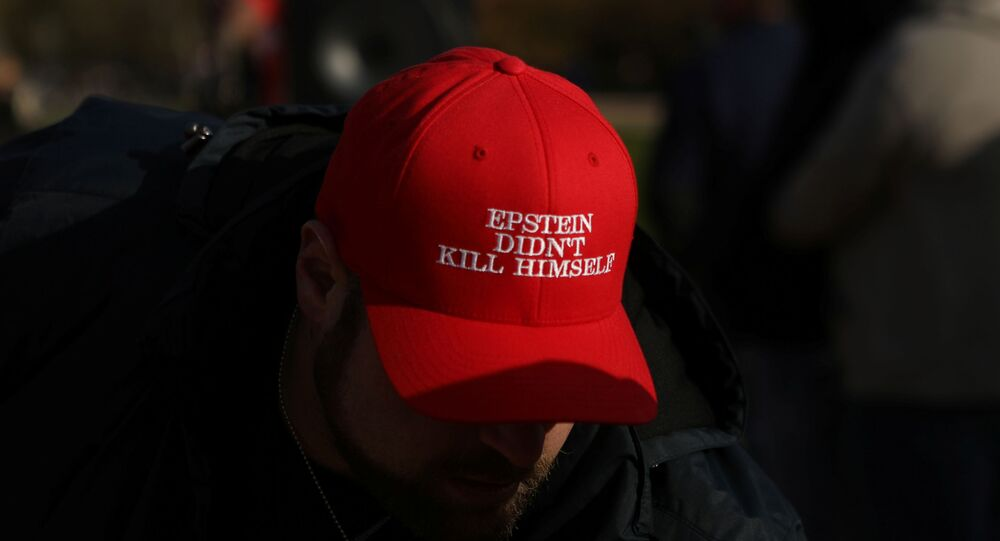 An attendee wears a hat that says Epstein Didn't Kill Himself as militia members and pro-gun rights activists participating in the Declaration of Restoration rally listen to speakers in Washington, DC, 9 November 2019