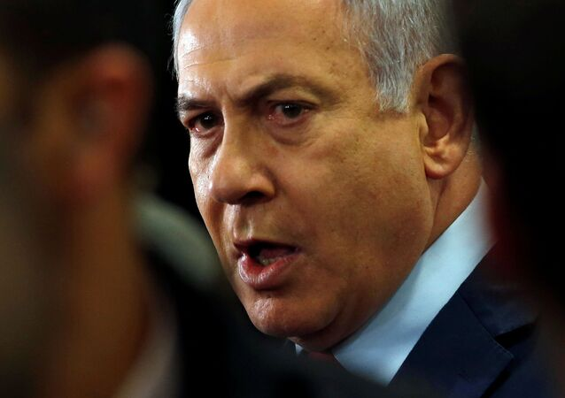 Israeli Prime Minister Benjamin Netanyahu speaks to the media at the Knesset