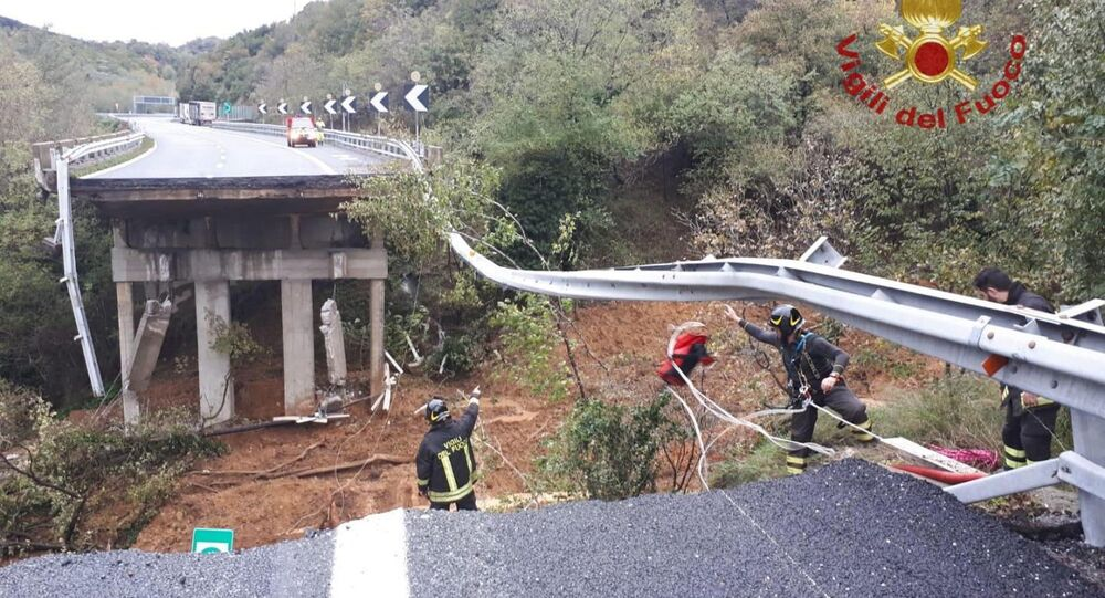 A portion of a motorway bridge linking Savona to Turin is seen after it collapsed due to a landslide near Savona, Italy, November 24, 2019.