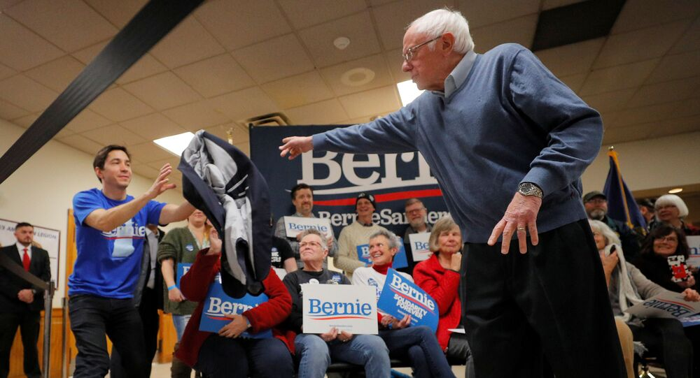 Democratic 2020 U.S. presidential candidate and U.S. Senator Bernie Sanders (I-VT) tosses his suit coat to actor and supporter Justin Long at a campaign town hall meeting in Hillsborough, New Hampshire, U.S., November 24, 2019.
