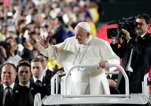 Pope Francis waves as he arrives to conduct a Holy Mass at the Tokyo Dome, in Tokyo, Japan, 25 November 2019.