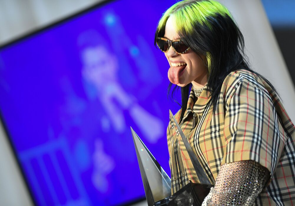 US singer/songwriter Billie Eilish poses with her awards for New Artist of the Year and Alternative Artist in the press room during the 2019 American Music Awards at the Microsoft theatre on 24 November 2019 in Los Angeles.