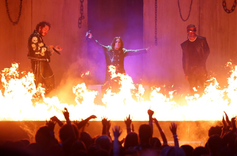 Post Malone, Ozzy Osbourne and Travis Scott perform at the 2019 American Music Awards show in Los Angeles on 24 November 2019.