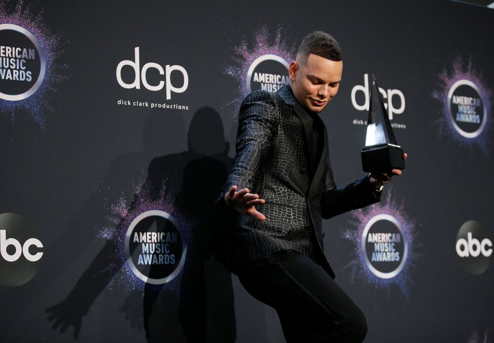 Kane Brown poses with his award for Favourite Album-Country for Experiment in the photo room at the 2019 American Music Awards show in Los Angeles on 24 November 2019.