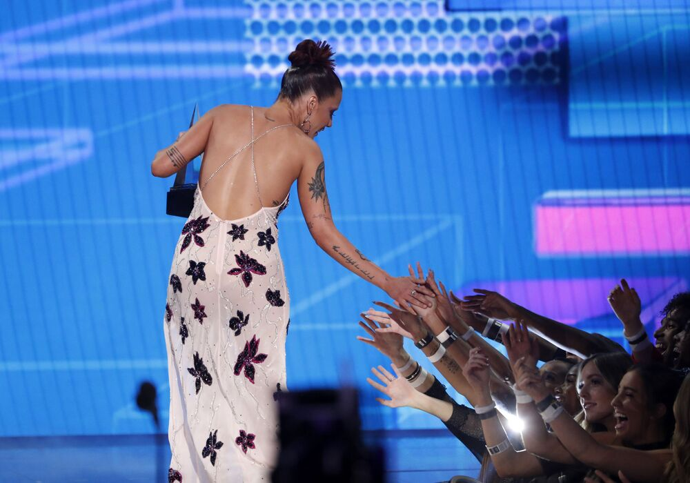 Halsey celebrates with audience members as she accepts the Favourite Song Pop/Rock award for Without Me at the 2019 American Music Awards show in Los Angeles on 24 November 2019.