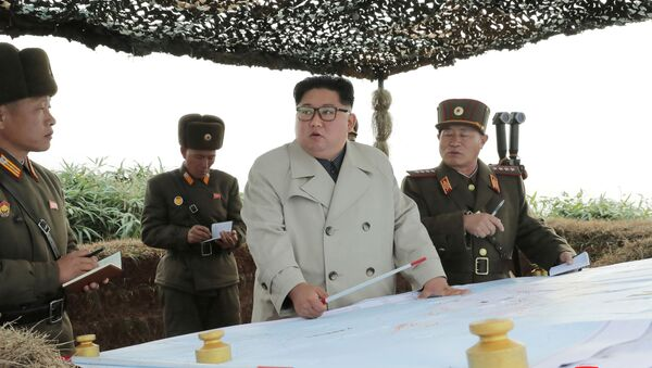 North Korean leader Kim Jong Un visits the Changrindo defensive position on the west front, in this undated picture released by North Korea's Central News Agency (KCNA) on November 25, 2019 - Sputnik International