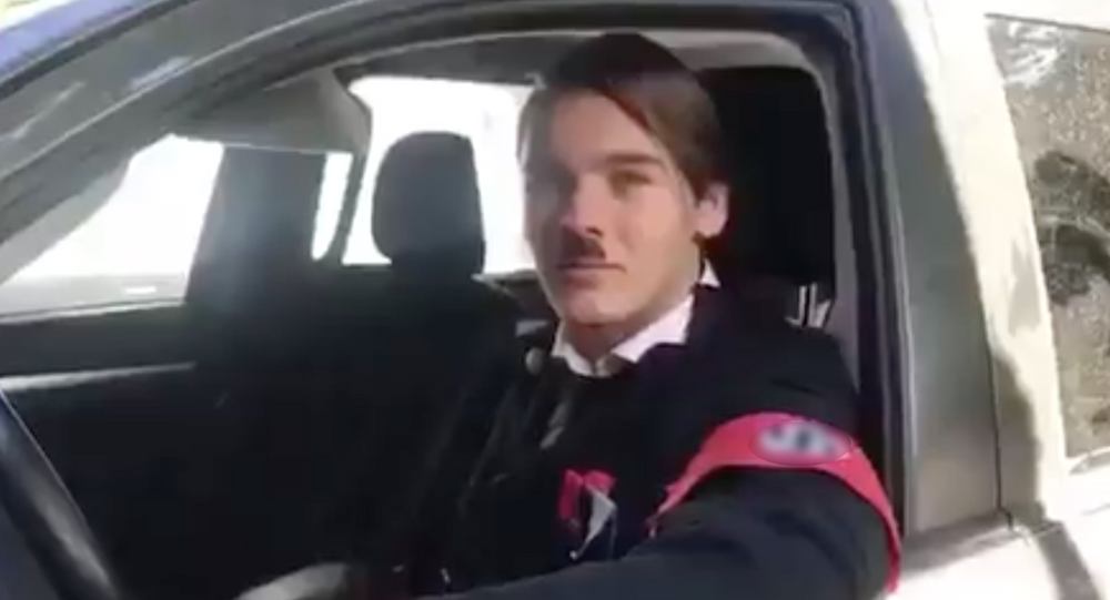 A student from Argentina dressed as Adolf Hitler in a parody music video