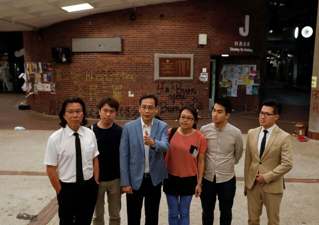 Pro-democratic lawmakers talk to the media after meeting with protesters at the Polytechnic University (PolyU) in Hong Kong, China November 25, 2019.