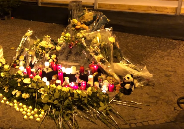 Candlelight vigil tribute constructed for two-year-old who died after being struck by an ice sculpture shard in Luxembourg's Christmas Market