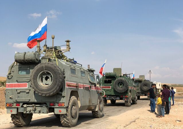 Russian military police armored vehicles in the town of Kobani