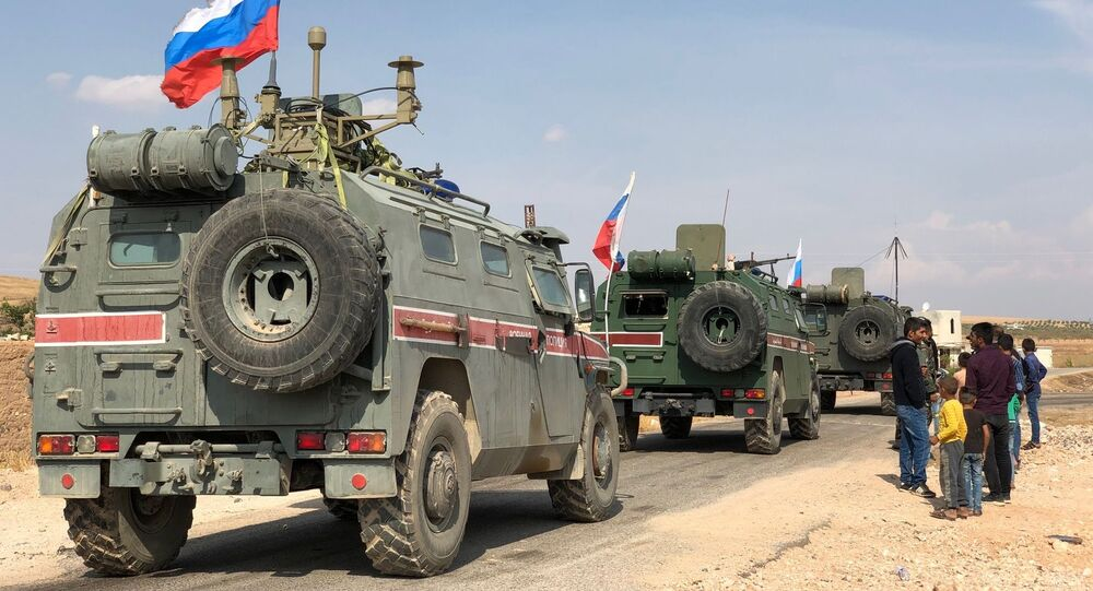 A Russian military police armored vehicles in the town of Kobani