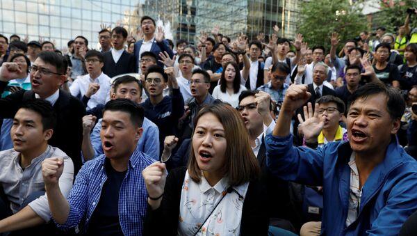 Pro-democratic winning candidates gather outside the campus of the Polytechnic University (PolyU) in Hong Kong - Sputnik International