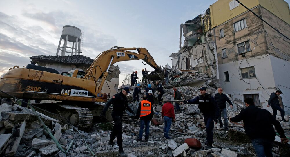 Emergency personnel work near a damaged building in Thumane, after an earthquake shook Albania, November 26, 2019