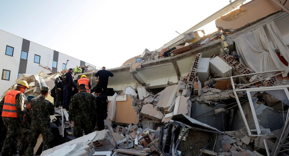 Military and emergency personnel work near a damaged building in Durres, after an earthquake shook Albania, November 26, 2019