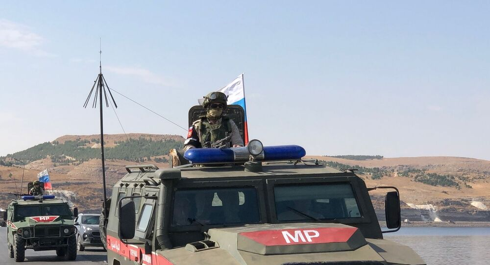 A Russian military police officer near the Euphrates River
