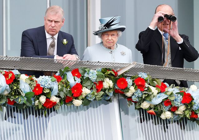 Britain's Queen Elizabeth watches the Epsom Derby with Prince Andrew (L) and Prince Philip, the Duke of Edinburgh, in Epsom, south of London June 1, 2013