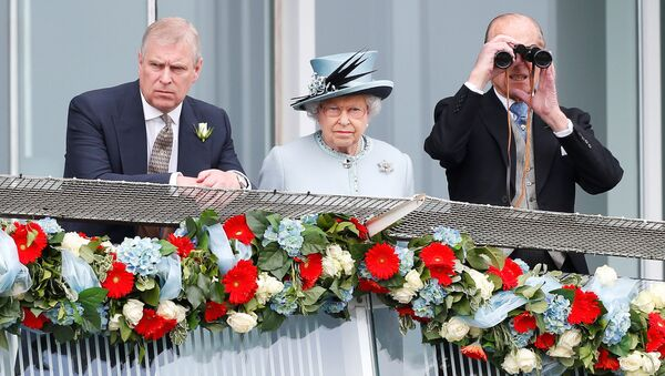 Britain's Queen Elizabeth watches the Epsom Derby with Prince Andrew (L) and Prince Philip, the Duke of Edinburgh, in Epsom, south of London June 1, 2013 - Sputnik International