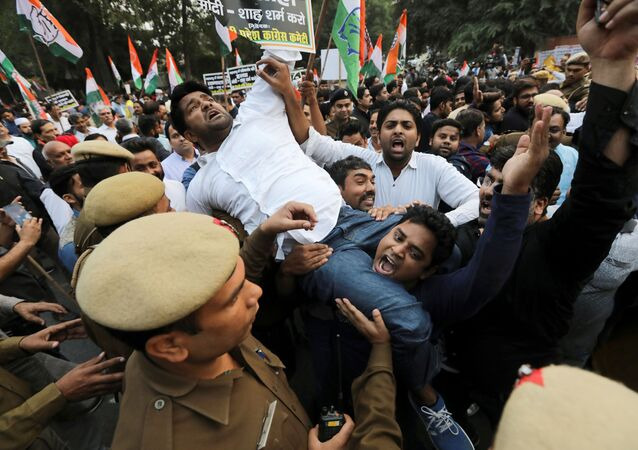 Supporters of India's main opposition Congress party shout slogans as they are stopped by police during a protest against the formation of a Bharatiya Janata Party (BJP) led coalition government in Maharashtra, 25 November 2019
