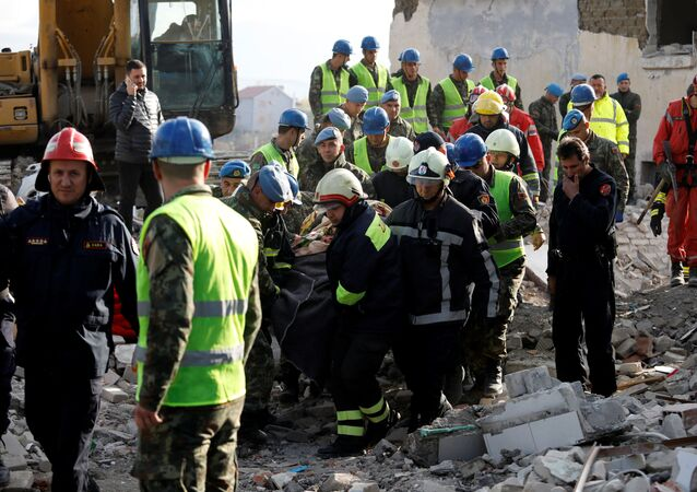 Emergency personnel carry a body in the town of Thumane, following Tuesday's powerful earthquake that shook Albania, November 27, 2019.