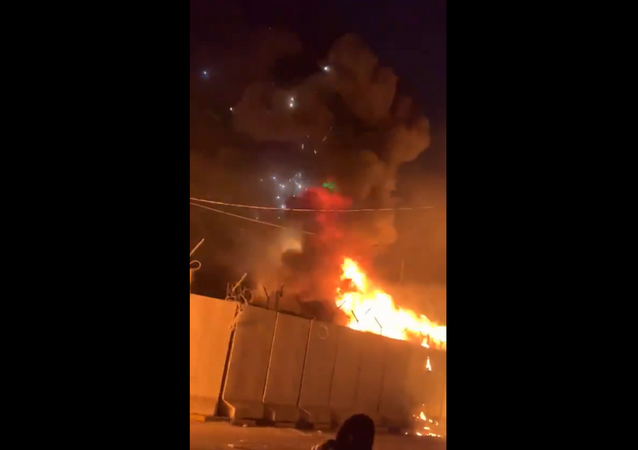 Video footage captures moment anti-government protesters torch Iranian consulate in Najaf, Iraq.