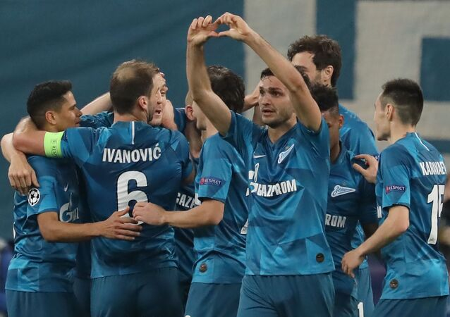 Zenit's Magomed Ozdoev celebrates with teammates after scoring a goal during the Champions League Group G soccer match between Zenit St. Petersburg and Olympique Lyonnais, in St. Petersburg, Russia.