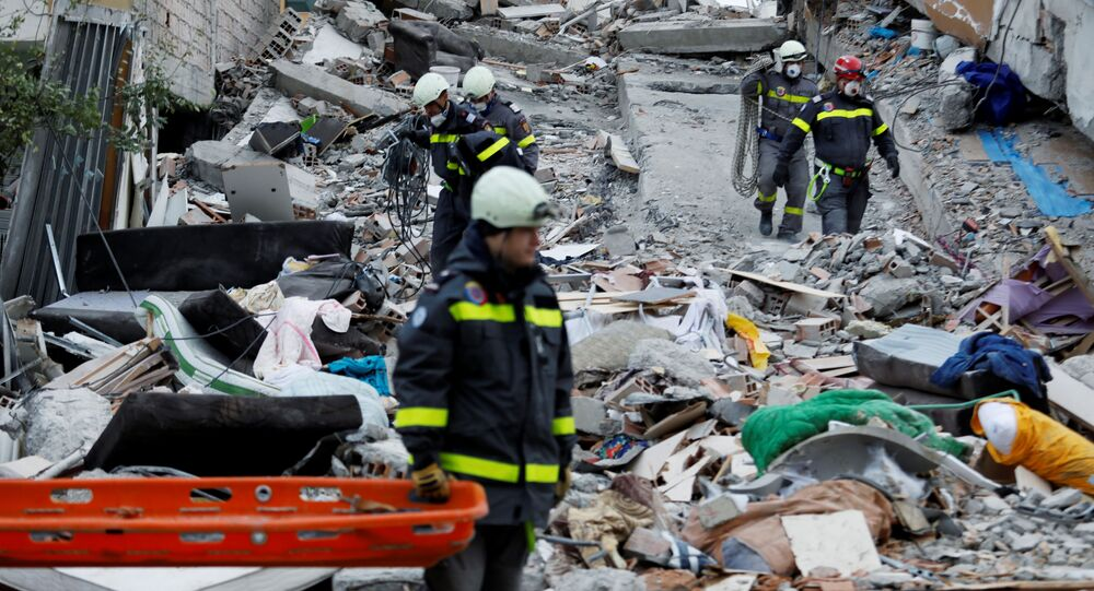 Emergency personnel search for survivors in a collapsed building in Durres, after an earthquake shook Albania, November 28, 2019