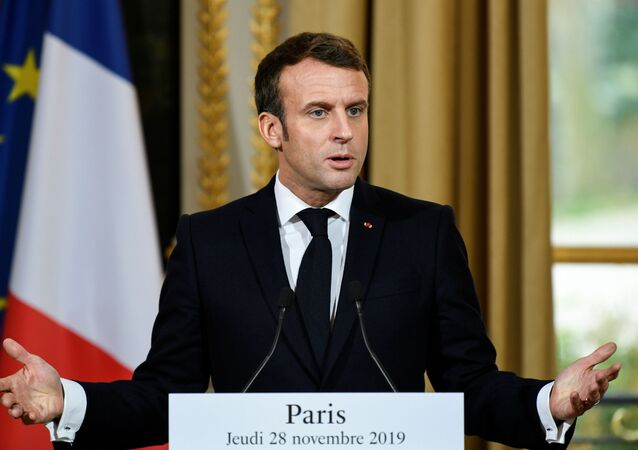 French President Emmanuel Macron gives a news conference after a meeting with NATO Secretary General Jens Stoltenberg at the Elysee palace in Paris, France, 28 November 2019