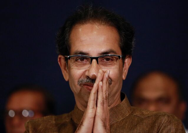 Shiv Sena chief Uddhav Thackeray greets people after arriving at a press conference with Nationalist Congress Party president Sharad Pawar in Mumbai, India, November 23, 2019
