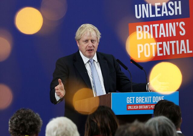 Britain's Prime Minister Boris Johnson makes a speech to an audience as he visits Healey's Cornish Cyder Farm, in Callestick, Britain, November 27, 2019.
