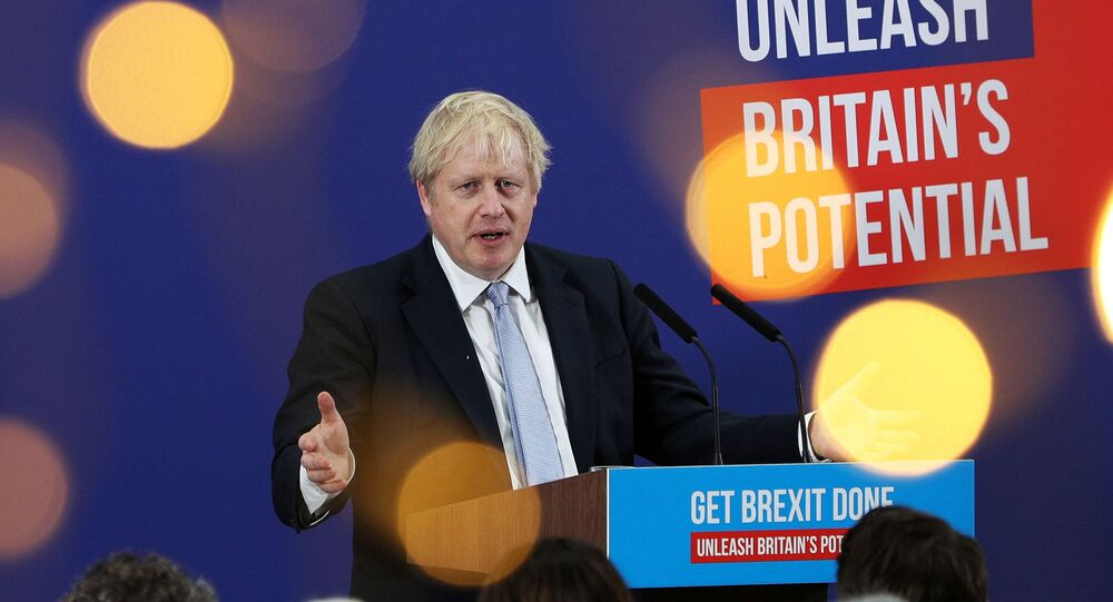 Britain's Prime Minister Boris Johnson makes a speech to an audience as he visits Healey's Cornish Cyder Farm, in Callestick, Britain, 27 November 2019.