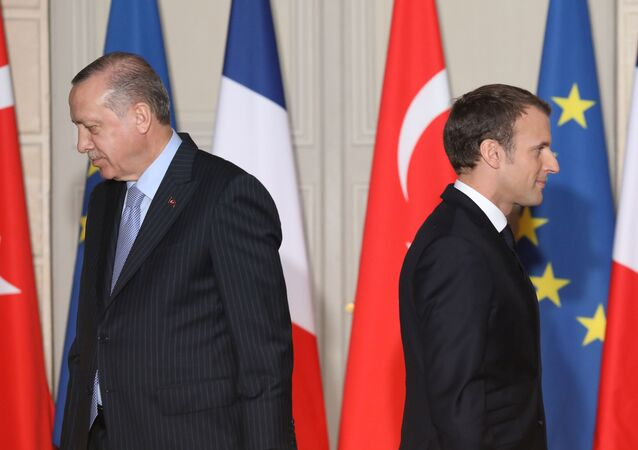 (FILES) In this file photo taken on January 5, 2018, French President Emmanuel Macron (R) and Turkish President Recep Tayyip Erdogan walk during a joint press conference, at the Elysee Palace in Paris. The French government will summon the Turkish envoy in Paris for talks after what it termed insults by Turkey's President Recep Tayyip Erdogan, who accused Emmanuel Macron of suffering brain death, the president's office said on November 29, 2019.