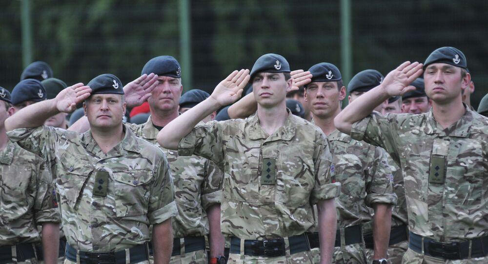Britain's servicemen attend an opening ceremony for the Rapid Trident/Saber Guardian 2015 military exercises