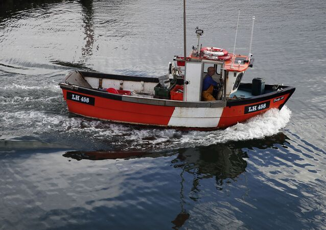 A fishing boat enters the port of Eyemouth, on the southern coast of Edinburgh, Scotland