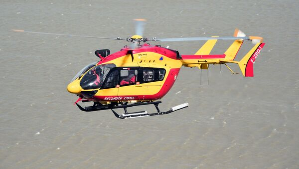 In this file photo taken on May 05, 2015 A French Civilian Security EC145 helicopter flies next to Mont-Saint-Michel in Normandy during a large air evacuation drill, in order to test coordination of air assets in the event of a potential crisis scenario at the site. - Three emergency workers were killed in a helicopter crash near Marseille while on a rescue mission in southern France where floods have left two dead, officials said December 2, 2019. - Sputnik International
