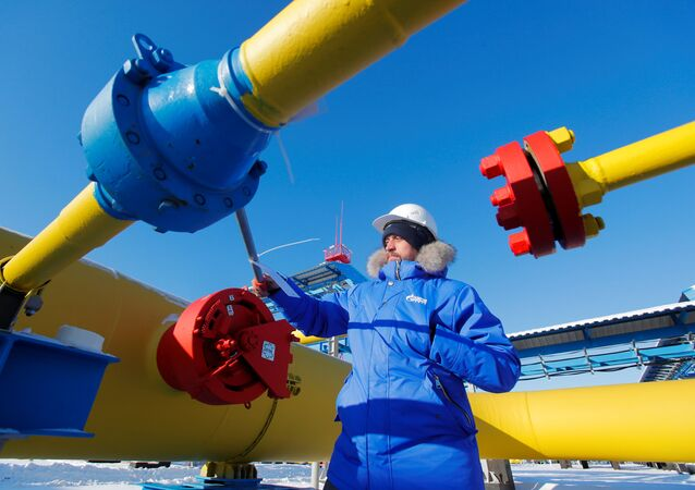 An employee checks a gas valve at the Atamanskaya compressor station, part of Gazprom's Power Of Siberia gas pipeline outside the far eastern town of Svobodny, in Amur region, Russia November 29, 2019