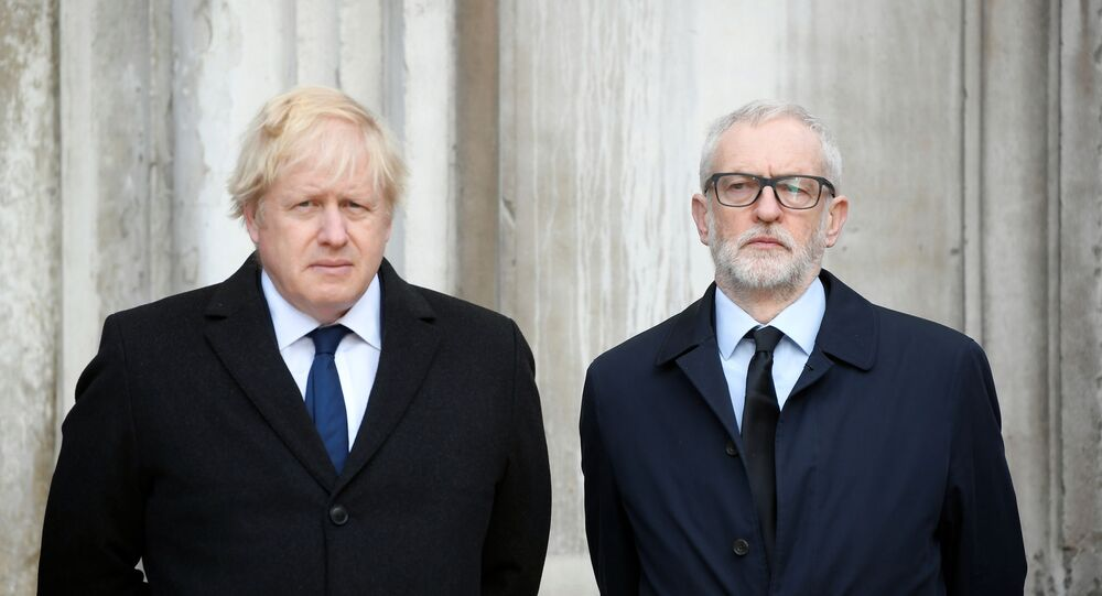 Britain's Prime Minister Boris Johnson and Britain's opposition Labour Party leader Jeremy Corbyn attend a vigil for victims of a fatal attack on London Bridge in London, Britain December 2, 2019