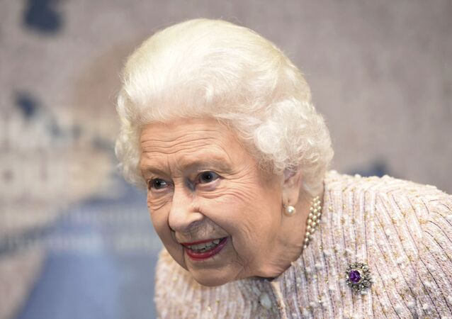 Britain's Queen Elizabeth II smiles as she attends the Royal institute of International Affairs in Chatham House, London