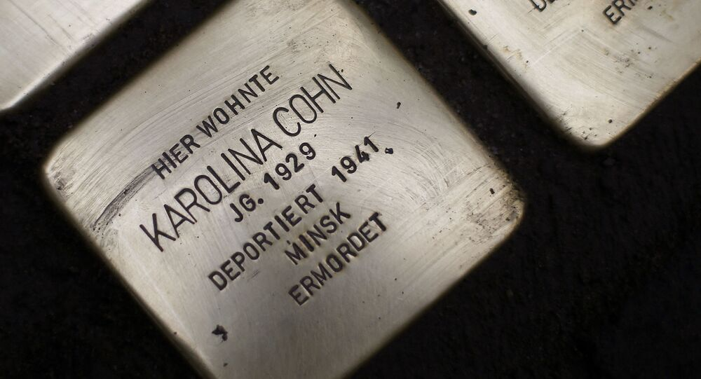 Stolpersteine (stumbling blocks) have been laid for Karolina Cohn and her family at a place where they once lived  in Frankfurt, Germany, Monday, Nov. 13, 2017