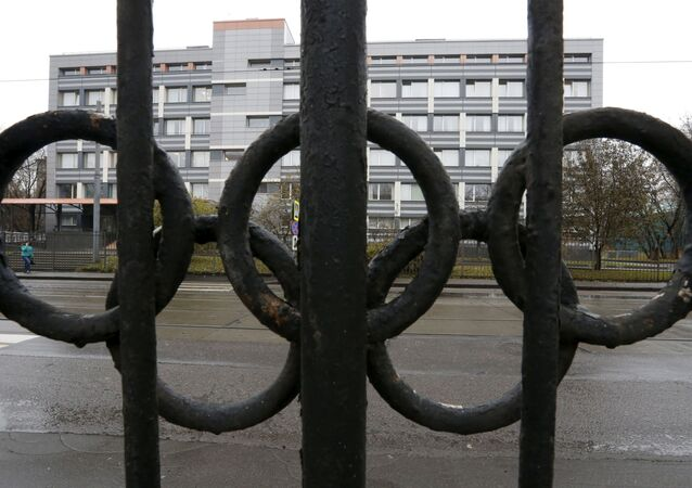 A view through a fence decorated with the Olympic rings shows a building of the federal state budgetary institution which houses a laboratory accredited by the World Anti-Doping Agency (WADA), in Moscow