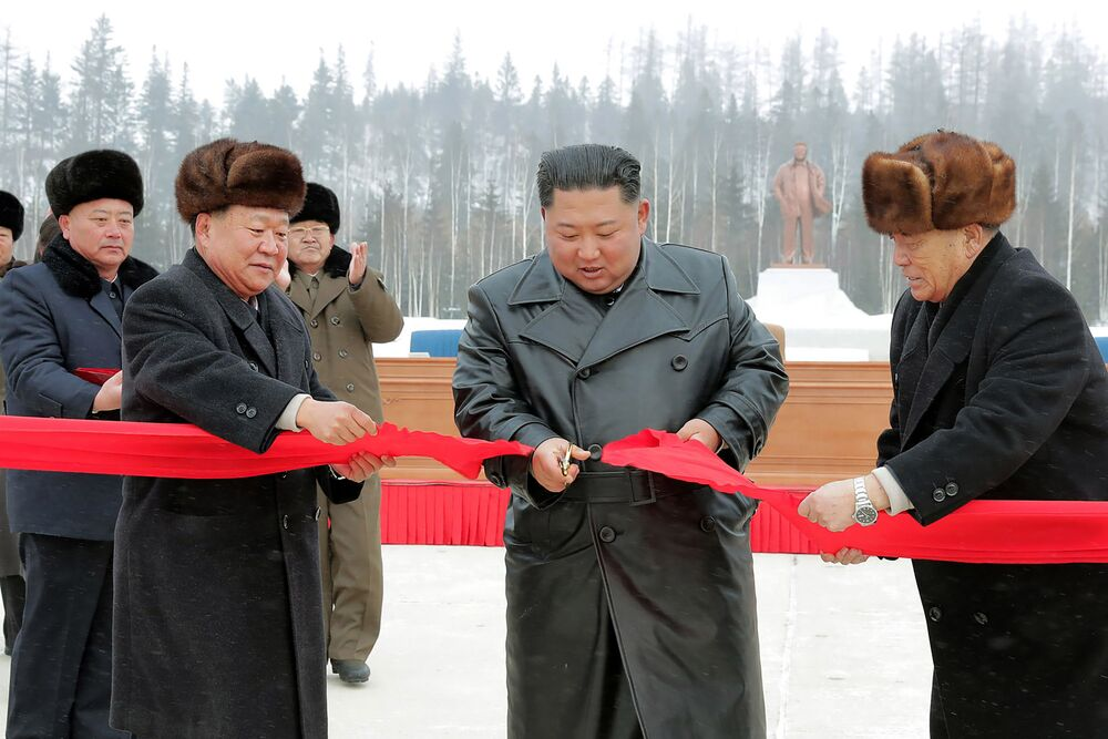 This picture taken on December 2, 2019 and released from North Korea's official Korean Central News Agency (KCNA) on December 3, 2019 shows North Korean leader Kim Jong Un (2nd R) cutting a ribbon to mark the completion of the construction of the township of Samjiyon County.