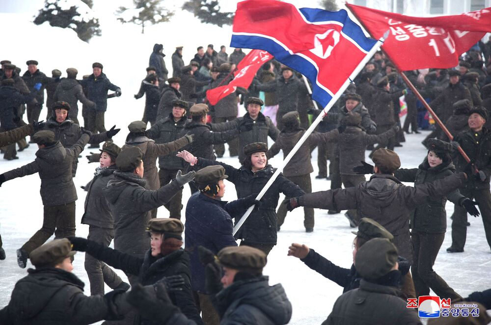 People dance during a ceremony celebrating the completion of township of Samjiyon County, North Korea, in this undated picture released by North Korea's Central News Agency (KCNA) on December 2, 2019.
